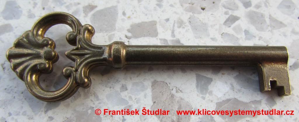 16 - dozický klíč